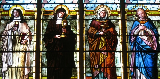 Stained glass of Saints Teresa of Avila, Clare of Assisi, Monica, and the Immaculate Conception – St. Luke Catholic Church – Danville, OH